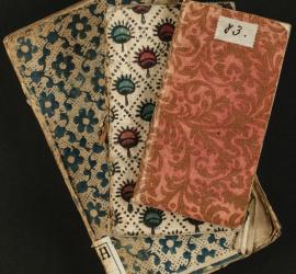 Reliures brochées composées de différents papiers, dominoté et gaufré doré. 18e siècle [Mit. H.7.13], [UU.12°.1072] et [UU.12°.1055]